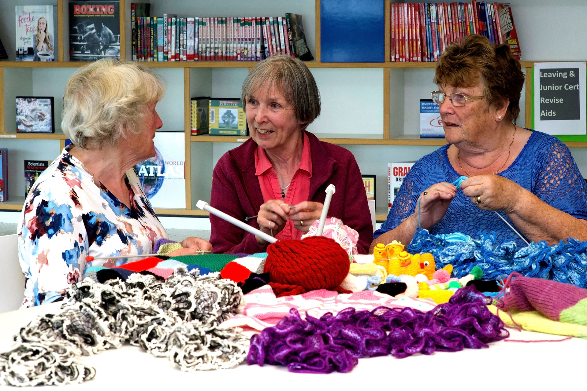 grannies having a chat while knitting
